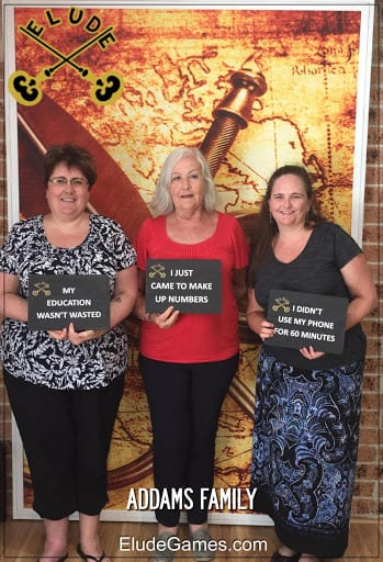 Jane and Family team photo at Elude Escape Rooms